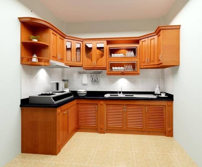 Mẫu tủ bếp gỗ xoan đào với thiết kế hiện đại cùng màu gỗ tự nhiên vô cùng bắt mắt.